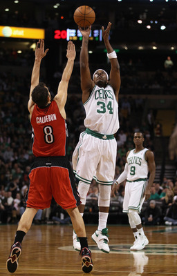 BOSTON, MA - JANUARY 07:  Paul Pierce #34 of the Boston Celtics takes a shot as Jose Calderon #8 of the Toronto Raptors defends on January 7, 2011 at the TD Garden in Boston, Massachusetts. NOTE TO USER: User expressly acknowledges and agrees that, by dow