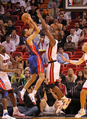 MIAMI, FL - DECEMBER 01: Tayshaun Prince #22 of the Detroit Pistons shoots over Chris Bosh #1 of the Miami Heat during a game at American Airlines Arena on December 1, 2010 in Miami, Florida. NOTE TO USER: User expressly acknowledges and agrees that, by d