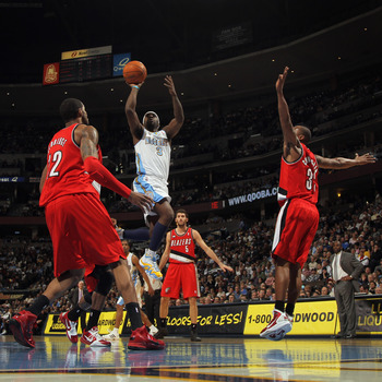 DENVER - DECEMBER 28:  Ty Lawson #3 of the Denver Nuggets takes a shot between Wesley Matthews #2 and Dante Cunningham #33 of the Portland Trail Blazers at Pepsi Center on December 28, 2010 in Denver, Colorado. The Nuggets defeated the Blazers 95-77. NOTE