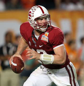 MIAMI, FL - JANUARY 03:  Quarterback Andrew Luck #12 of the Stanford Cardinal rolls out of the pocket against the Virginia Tech Hokies during the 2011 Discover Orange Bowl at Sun Life Stadium on January 3, 2011 in Miami, Florida. Stanford won 40-12. (Phot