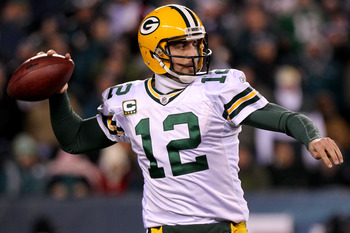 PHILADELPHIA, PA - JANUARY 09:  Aaron Rodgers #12 of the Green Bay Packers prepares to pass against the Philadelphia Eagles during the 2011 NFC wild card playoff game at Lincoln Financial Field on January 9, 2011 in Philadelphia, Pennsylvania.  (Photo by