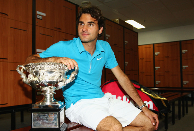 MELBOURNE, AUSTRALIA - JANUARY 31:  Roger Federer of Switzerland poses with the Norman Brookes Challenge Cup in the players locker room after winning the men's final match against Andy Murray of Great Britain during day fourteen of the 2010 Australian Ope