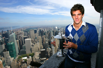 NEW YORK - SEPTEMBER 15: Juan Martin Del Potro the 2009 US Open Tennis Champion poses with the US Open trophy on a viewing deck at the Empire State Building on September 15, 2009 in New York City.  (Photo by Chris Trotman/Getty Images for ATP Tour)