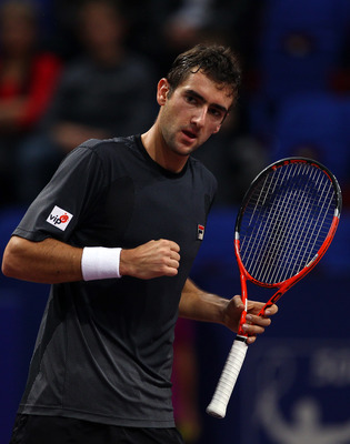 BASEL, SWITZERLAND - NOVEMBER 04:  Marin Cilic of Croatia celebrates winning a game in his match against David Nalbandian of Argentina during Day Four of the Davidoff Swiss Indoors Tennis at St Jakobshalle on November 4, 2010 in Basel, Switzerland.  (Phot