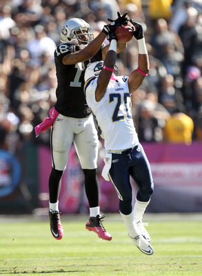 OAKLAND, CA - OCTOBER 10:  Antoine Cason #20 of the San Diego Chargers breaks up a pass intended for Louis Murphy #18 of the Oakland Raiders at Oakland-Alameda County Coliseum on October 10, 2010 in Oakland, California.  (Photo by Ezra Shaw/Getty Images)