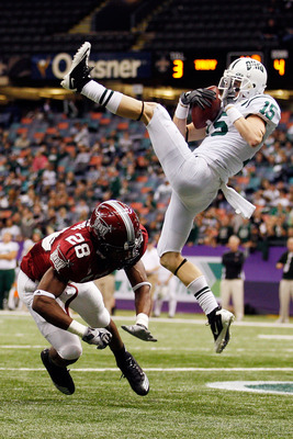 NEW ORLEANS, LA - DECEMBER 18:  Riley Dunlop #15 of the Ohio University Bobcats scores a touchdown over Cameron Hudson #28 of the Troy University Trojans  during the R&L Carriers New Orleans Bowl at the Louisiana Superdome on December 18, 2010 in New Orle
