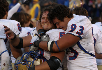 SOUTH BEND, IN - OCTOBER 30: Cory Dorris #93 of the Tulsa Golden Hurricane hugs teammate Trent Dupy #53 after a win over the Notre Dame Fighting Irish at Notre Dame Stadium on October 30, 2010 in South Bend, Indiana. Tulsa defeated Notre Dame 28-27. (Phot