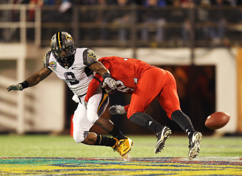 ORLANDO, FL - DECEMBER 28:  Jock Sanders #9 of the West Virginia Mountineers misses a catch defended by Nate Irving #56 of the North Carolina State Wolfpack during the Champs Sports Bowl at Florida Citrus Bowl Stadium on December 28, 2010 in Orlando, Flor