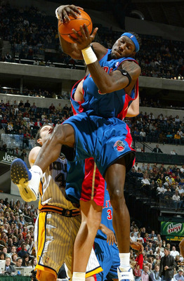 INDIANAPOLIS - DECEMBER 19:  Ben Wallace #3 of the Detroit Pistons grabs a rebound against the Indiana Pacers on December19, 2003 at Conseco Fieldhouse in Indianapolis, Indiana. NOTE TO USER: User expressly acknowledges and agress that, by downloading and