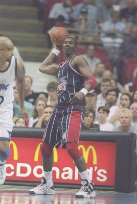 18 Oct 1996: Center Hakeem Olajuwom of the Houston Rockets prepares to pass the ball during a game against the Orlando Magic at Orlando Arena in Orlando, Florida. The Magic won the game 95 - 83.