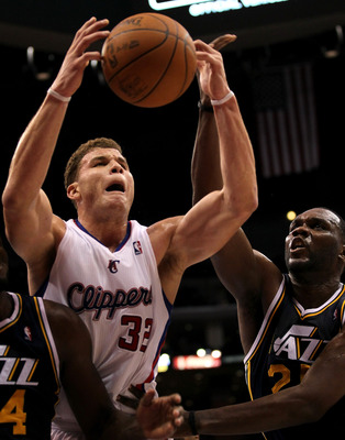 LOS ANGELES, CA - DECEMBER 29: Blake Griffin #32 of the Los Angeles Clippers goes for a rebound against Al Jefferson #25 of the Utah Jazz at Staples Center on December 29, 2010 in Los Angeles, California.       The Jazz won 103-85.  NOTE TO USER: User exp