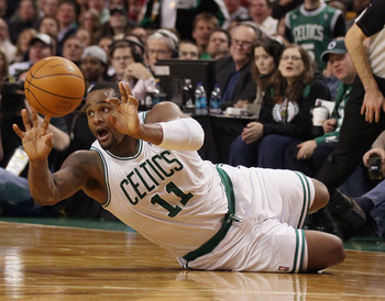 BOSTON, MA - JANUARY 10:  Glen Davis #11 of the Boston Celtics passes the ball after he knocked it away from Patrick Patterson of he Houston Rockets on January 10, 2011 at the TD Garden in Boston, Massachusetts.  NOTE TO USER: User expressly acknowledges