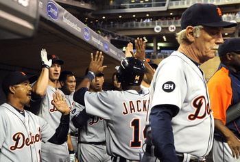 MINNEAPOLIS, MN - JUNE 28:  Detroit Tigers celebrate as Austin Jackson #14 returns to the dugout after scoring on a Ryan Raburn single in the seventh inning against the Minnesota Twins during their game on June 28, 2010 at Target Field in Minneapolis, Min