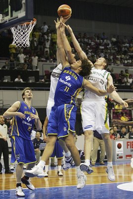 HAMAMATSU, JAPAN - AUGUST 24: Anderson Varejo of Brazil reaches for the ball against Lithuania during the preliminary round of FIBA World Championships 2006 on August 24, 2006 in Hamamatsu, Japan. The Championships take place from August 19 to September 3