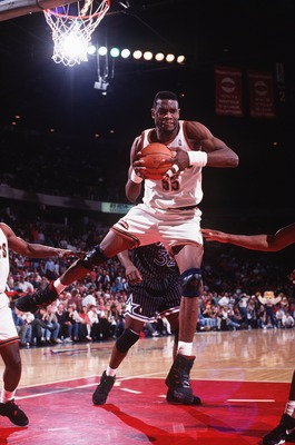 6 MAR 1994:  DENVER CENTER DIKEMBE MUTOMBO GRABS THE REBOUND DURING THE NUGGETS GAME AGAINST THE MINNESOTA TIMBERWOLVES. Mandatory Credit: Tim Defrisco/ALLSPORT