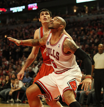 CHICAGO, IL - DECEMBER 28: Carlos Boozer #5 of the Chicago Bulls screens Ersan Ilyasova #7 of the Milwaukee Bucks at the United Center on December 28, 2010 in Chicago, Illinois. The Bulls defeated the Bucks 90-77. NOTE TO USER: User expressly acknowledges