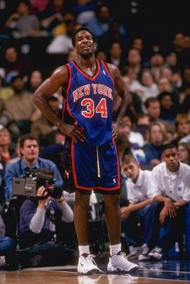 4 Dec 1997:  Forward Charles Oakley of the New York Knicks looks on during a game against the Dallas Mavericks at the Reunion Arena in Dallas, Texas.  The Mavericks won the game, 105-91. Mandatory Credit: Brian Bahr  /Allsport
