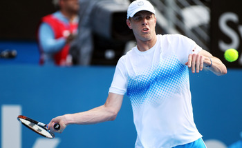 SYDNEY, AUSTRALIA - JANUARY 12: Sam Querrey of the USA plays a forehand in his match against Alexandr Dolgopolov of Ukraine during day four of the 2011 Medibank International at Sydney Olympic Park Tennis Centre on January 12, 2011 in Sydney, Australia.