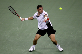 SHANGHAI, CHINA - OCTOBER 13:  Stanislas Wawrinka of Switzerland returns a shot to Rafael Nadal of Spain during day three of the 2010 Shanghai Rolex Masters at the Shanghai Qi Zhong Tennis Center on October 13, 2010 in Shanghai, China.  (Photo by Matthew