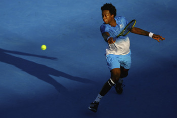 MELBOURNE, AUSTRALIA - JANUARY 14:  Gael Monfils of France plays a backhand during his match against Jurgen Melzer of Austria during day three of the AAMI Classic at Kooyong on January 14, 2011 in Melbourne, Australia.  (Photo by Robert Prezioso/Getty Ima