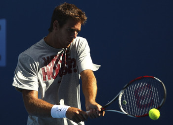 MELBOURNE, AUSTRALIA - JANUARY 14:  Juan Martin Del Potro of Argentina hits a backhand shot  during a practice session during a practice session ahead of the 2011 Australian Open at Melbourne Park on January 14, 2011 in Melbourne, Australia.  (Photo by Lu