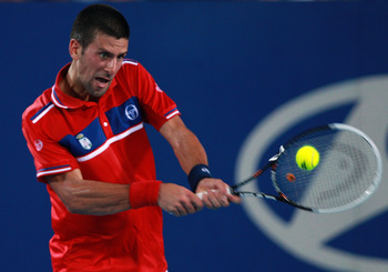 PERTH, AUSTRALIA - JANUARY 04:  Novak Djokovic of Serbia plays a return shot to Lleyton Hewitt of Australia during his singles match on day four of the Hopman Cup on January 4, 2011 in Perth, Australia.  (Photo by Paul Kane/Getty Images)