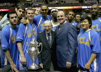 ANAHEIM, CA - DECEMBER 10:  The UCLA Bruins stand with John Wooden after defeating the Nevada Wolf Pack 67-56 during the 12th Annual John R. Wooden Classic on December 10, 2005 at Arrowhead Pond of Anaheim in Anaheim, California.  (Photo by Lisa Blumenfel