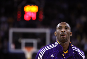 OAKLAND, CA - JANUARY 12: Kobe Bryant #24 of the Los Angeles Lakers stands for the National Anthem before their game against the Golden State Warriors at Oracle Arena on January 12, 2011 in Oakland, California. NOTE TO USER: User expressly acknowledges an