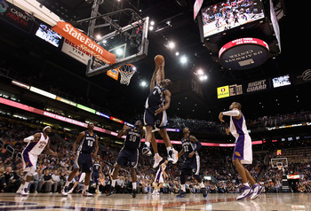 PHOENIX - DECEMBER 08:  Sam Young #4 of the Memphis Grizzlies jumps for a rebound against the Phoenix Suns during the NBA game at US Airways Center on December 8, 2010 in Phoenix, Arizona. NOTE TO USER: User expressly acknowledges and agrees that, by down