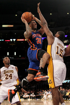 LOS ANGELES, CA - JANUARY 09:  Wilson Chandler #21 of the New York Knicks goes up for a shot over Andrew Bynum #17 of the Los Angeles Lakers at Staples Center on January 9, 2011 in Los Angeles, California.  The Lakers won 109-87.   NOTE TO USER: User expr