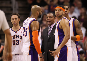 PHOENIX - JANUARY 07:  Head coach Alvin Gentry of the Phoenix Suns talks with Steve Nash #12, Vince Carter #25, Goran Dragic #2 and Channing Frye #8 during the NBA game against the New York Knicks at US Airways Center on January 7, 2011 in Phoenix, Arizon