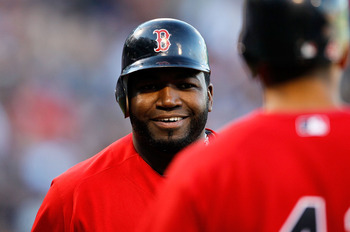 BOSTON - OCTOBER 2:  David Ortiz #34 of the Boston Red Sox smiles after scoring a run in the first inning during the first game of a doubleheader against the New York yankees at Fenway Park October 2, 2010 in Boston, Massachusetts. (Photo by Jim Rogash/Ge