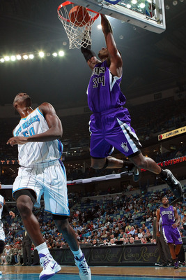 NEW ORLEANS, LA - DECEMBER 15:  Jason Thompson #34 of the Sacramento Kings dunks the ball over Emeka Okafor #50 of the New Orleans Hornets  at the New Orleans Arena on December 15, 2010 in New Orleans, Louisiana.  NOTE TO USER: User expressly acknowledges