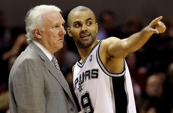 SAN ANTONIO, TX - DECEMBER 28:  Guard Tony Parker #9 of the San Antonio Spurs with Gregg Popovich during play against the Los Angeles Lakers at AT&amp;T Center on December 28, 2010 in San Antonio, Texas.  NOTE TO USER: User expressly acknowledges and agrees t