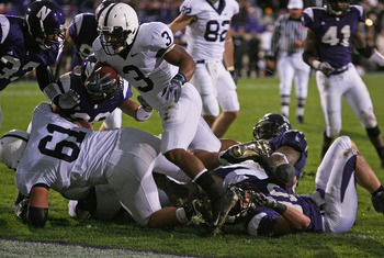 EVANSTON, IL - OCTOBER 31: Brandon Beachum #3 of the Penn State Nittany Lions hops over teammate Stefen Wisniewski #61 and Brian Peters #10 of the Northwestern Wildcats to score a touchdown at Ryan Field on October 31, 2009 in Evanston, Illinois. Penn Sta