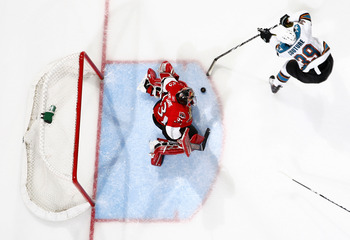 OTTAWA, ON - DECEMBER 02:  Logan Couture #39 of the San Jose Sharks slides the puck five-hole on Pascal Leclaire #33 of the Ottawa Senators for a goal in a game at Scotiabank Place on December 2, 2010 in Ottawa, Ontario, Canada.  (Photo by Phillip MacCall