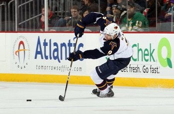 NEWARK, NJ - DECEMBER 31:  Evander Kane #9 of the Atlanta Thrashers skates against the New Jersey Devils at the Prudential Center on December 31, 2010 in Newark, New Jersey. The Devils defeated the Thrashers 3-1.  (Photo by Jim McIsaac/Getty Images)