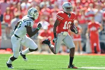 COLUMBUS, OH - SEPTEMBER 18:  Corey Brown #10 of the Ohio State Buckeyes runs with the ball as Travis Carrie #18 of the Ohio Bobcats defends at Ohio Stadium on September 18, 2010 in Columbus, Ohio.  (Photo by Jamie Sabau/Getty Images)
