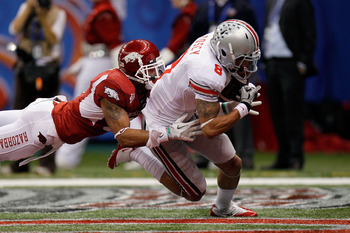 NEW ORLEANS, LA - JANUARY 04:  DeVier Posey #8 of the Ohio State Buckeyes catches a 43-yard touchdown catch against Tramain Thomas #5 of the Arkansas Razorbacks in the second quarter during the Allstate Sugar Bowl at the Louisiana Superdome on January 4,