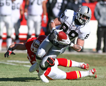 KANSAS CITY, MO - JANUARY 02:  Wide receiver Nick Miller #89 of the Oakland Raiders is tackled by linebacker Cory Greenwood #93 of the Kansas City Chiefs in a game at Arrowhead Stadium on January 2, 2011 in Kansas City, Missouri.  (Photo by Tim Umphrey/Ge
