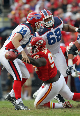 KANSAS CITY, MO - OCTOBER 31:  Wallace Gilberry #92 of the Kansas City Chiefs strips the ball from the hands of quarterback Ryan Fitzpatrick #14 of the Buffalo Bills during the game on October 31, 2010  at Arrowhead Stadium in Kansas City, Missouri.  (Pho
