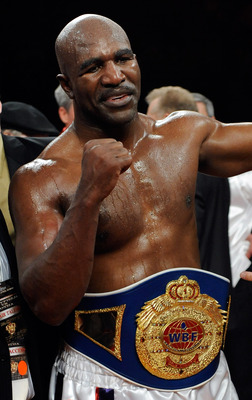 LAS VEGAS - APRIL 10:  Evander Holyfield celebrates his eighth-round TKO victory over Francois Botha in their heavyweight bout at the Thomas & Mack Center April 10, 2010 in Las Vegas, Nevada.  (Photo by Ethan Miller/Getty Images)