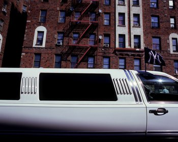 NEW YORK - SEPTEMBER 20: A New York Yankees flag waves on a limousine parked in the streets behind Yankee Stadium on September 20, 2008 in the Bronx borough of New York City. The Yankees are playing their final season in the 85 year old ball park and plan