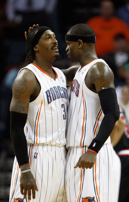 CHARLOTTE, NC - JANUARY 12:  Teammates Gerald Wallace #3 and Stephen Jackson #1 of the Charlotte Bobcats react during their 96-91 victory over the Chicago Bulls at Time Warner Cable Arena on January 12, 2011 in Charlotte, North Carolina. NOTE TO USER: Use
