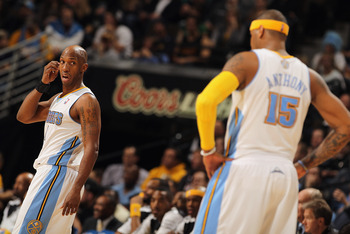 DENVER, CO - JANUARY 13:  Chauncey Billups #1 and Carmelo Anthony #15 of the Denver Nuggets look on during a break in the action against the Miami Heat at the Pepsi Center on January 13, 2011 in Denver, Colorado. The Nuggets defeated the Heat 130-102. NOT