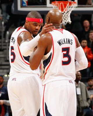 ATLANTA, GA - DECEMBER 11:  Josh Smith #5 and Damien Wilkins #3 of the Atlanta Hawks celebrate their 97-83 win over the Indiana Pacers at Philips Arena on December 11, 2010 in Atlanta, Georgia.  NOTE TO USER: User expressly acknowledges and agrees that, b
