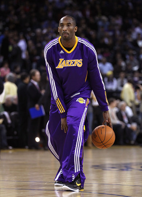 OAKLAND, CA - JANUARY 12: Kobe Bryant #24 of the Los Angeles Lakers warms up before their game against the Golden State Warriors at Oracle Arena on January 12, 2011 in Oakland, California. NOTE TO USER: User expressly acknowledges and agrees that, by down