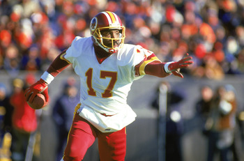1987:  Doug Williams #17 of the Washington Redskins scrambles with the ball during a 1987 NFL season game. (Photo by: Jonathan Daniel/Getty Images)