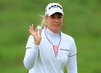 SOUTHPORT, ENGLAND - JULY 31:  Brittany Lincicome of the USA acknowledges the crowd on the 18th green during the third round of the 2010 Ricoh Women's British Open at Royal Birkdale on July 31, 2010 in Southport, England.  (Photo by David Cannon/Getty Ima