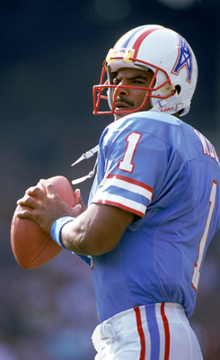 CLEVELAND - OCTOBER 29:  Quarterback Warren Moon #1 of the Houston Oilers sets to pass during an NFL game against the Cleveland Browns at Cleveland Stadium on October 29, 1989 in Cleveland, Ohio.  The Browns won 28-17.  (Photo by Brian Masck/Getty Images)